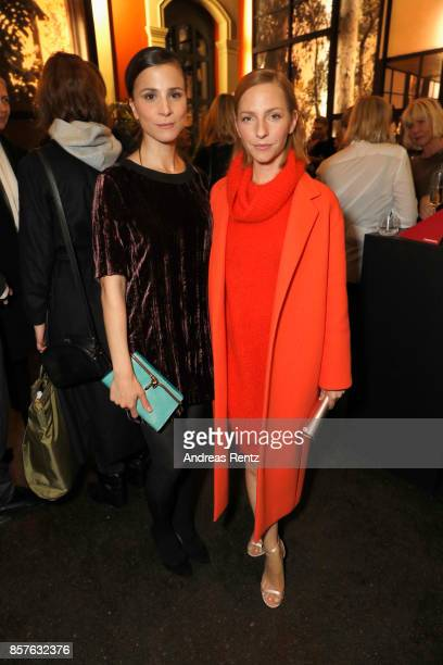 Aylin Tezel and Katharina Schuettler attend an EAMES Celebration by HUGO BOSS and Vitra Design Museum at Lapidarium on October 4 2017 in Berlin...