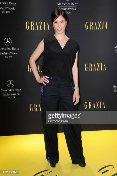 Aylin Tezel attends the MercedesBenz Fashion Week Berlin Spring/Summer 2014 Preview Show by Grazia at the Brandenburg Gate on July 1 2013 in Berlin...