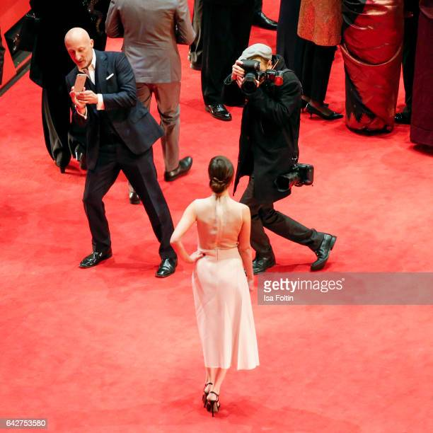 Aylin Tezel wearing Boss and film director Oliver Hirschbiegel attend the closing ceremony of the 67th Berlinale International Film Festival at...