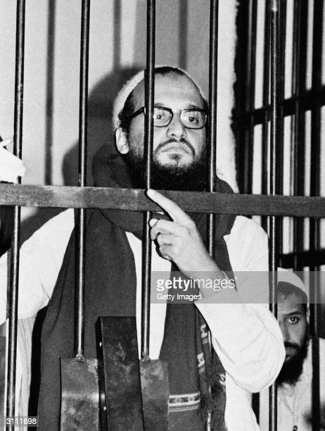 Ayman AlZawahri stands behind bars in an Egyptian court in 1982 during his trial as one of the masterminds behind the assassination of Egyptian...