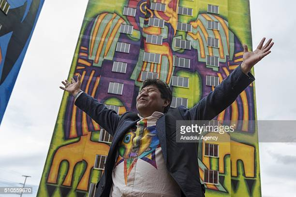 Aymara artist Roberto Mamani Mamani in front of the buildings he painted at the residential area 'Wiphala' a government's social housing project in...