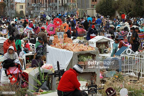 Aymara Indians celebrate All Saints day at Héroes del Gas Sur cemetery on November 02 La Paz Bolivia This ancient ceremony aims to honor the memory...