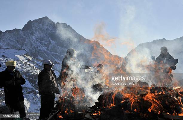 Aymara indigenous people perform a ritual to the Pachamama on August 1 2014 in La Cumbre 25 km from La Paz Bolivians will pay homage to the Pachamama...