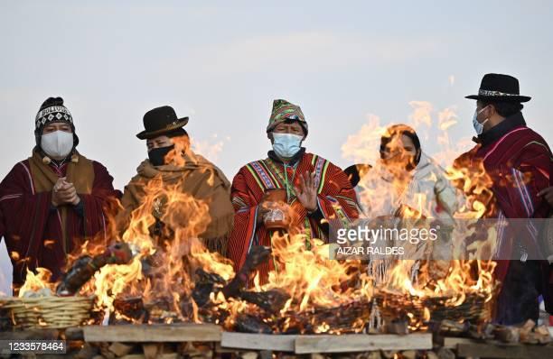 Aymara indigenous people take part in the celebration of the Aymara New Year in Tiwanaku, Bolivia, on June 21, 2021. - Bolivia resumed celebrations...