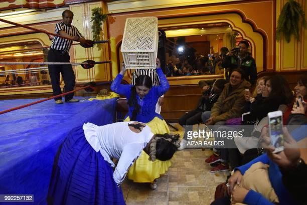 "Aymara indigenous women Elsa and ""La Simpatica Angela"" take part in a freestyle wrestling flight in El Alto, on June 29, 2018. - ""Cholita Fighters""..."