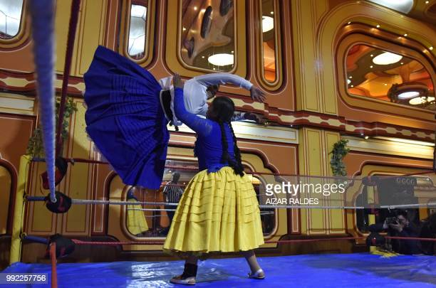 Aymara indigenous women Elsa and La Simpatica Angela take part in a freestyle wrestling flight in El Alto on June 29 2018 Cholita Fighters aim to...