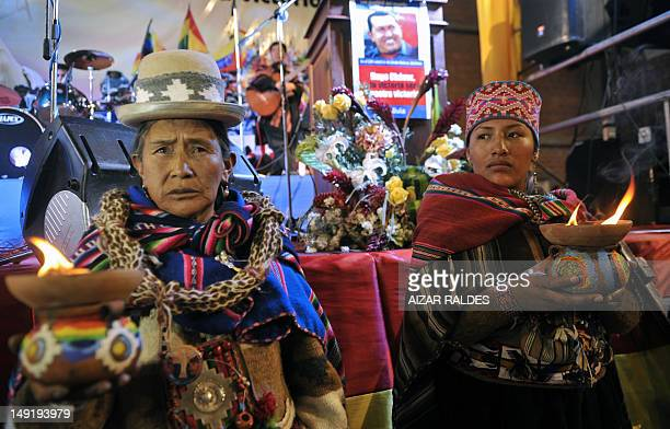 Aymara indigenous women make a ritual during a gathering of social movements' members in support of Venezuelan President Hugo Chavez on July 24 2012...