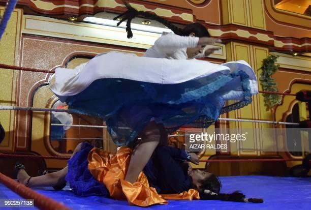 TOPSHOT Aymara indigenous women 'Martha La Altena' and 'Susana La Bonita' take part in a freestyle wrestling flight in El Alto on June 29 2018...