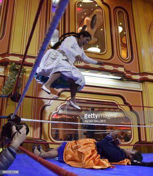 Aymara indigenous women 'Martha La Altena' and 'Susana La Bonita' take part in a freestyle wrestling flight in El Alto on June 29 2018 'Cholita...