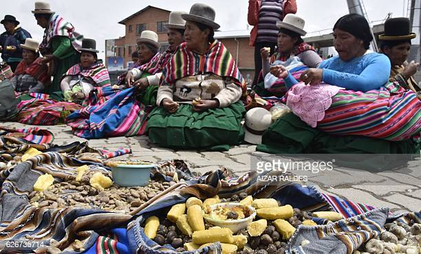 Aymara indigenous women take part in an 'apthapi' after a group of 'amautas' masters in Quechua language performed the ritual of Jallupacha to ask...