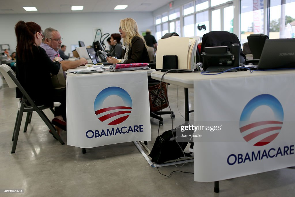 Aymara Marchante (L) and Wiktor Garcia sit with Maria Elena Santa Coloma, an insurance advisor with UniVista Insurance company, as they sign up for the Affordable Care Act, also known as Obamacare, before the February 15th deadline on February 5, 2015 in Miami, Florida. Numbers released by the government show that the Miami-Fort Lauderdale-West Palm Beach metropolitan area has signed up 637,514 consumers so far since open enrollment began on Nov. 15, which is more than twice as many as the next large metropolitan area, Atlanta, Georgia.
