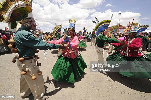 Aymara natives dance the Chunchu during celebrations for the 50th birthday of Bolivian President Evo Morales in the Aymara community of Batallas 70...