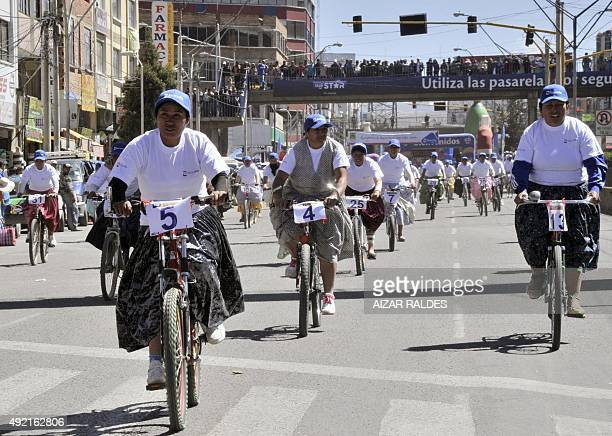 Aymaran native women take part in the Cholitas cycling race celebrating the day of Bolivian woman on October 10 in El Alto city 12 kilometers from La...