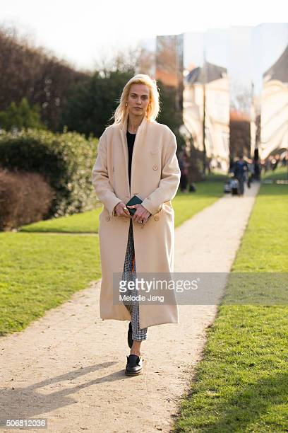 Aymeline Valade attends the Dior Couture show at Musee Rodin on January 25 2016 in Paris France