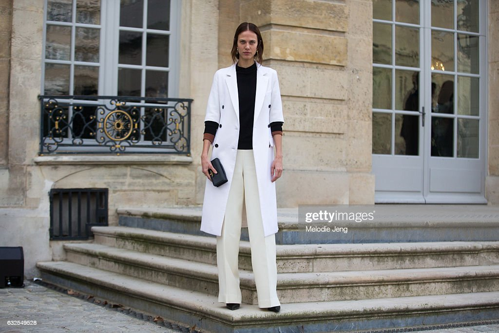 Aymeline Valade in a white jacket and pants outside the Dior Couture show at Musee Rodin on January 23, 2017 in Paris, France.