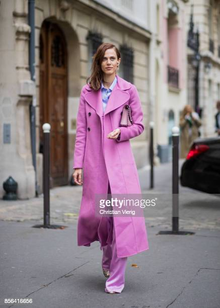 Aymeline Valade wearing a pink coat seen outside Valentino during Paris Fashion Week Spring/Summer 2018 on October 1 2017 in Paris France