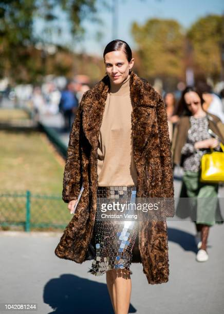 Aymeline Valade wearing silver glitter skirt brown coat beige knit is seen outside Paco Rabanne during Paris Fashion Week Womenswear Spring/Summer...