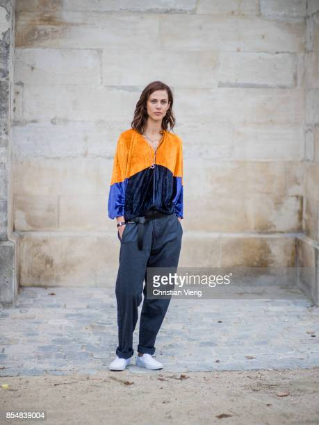 Aymeline Valade wearing velvet jacket is seen outside Lacoste during Paris Fashion Week Spring/Summer 2018 on September 27 2017 in Paris France
