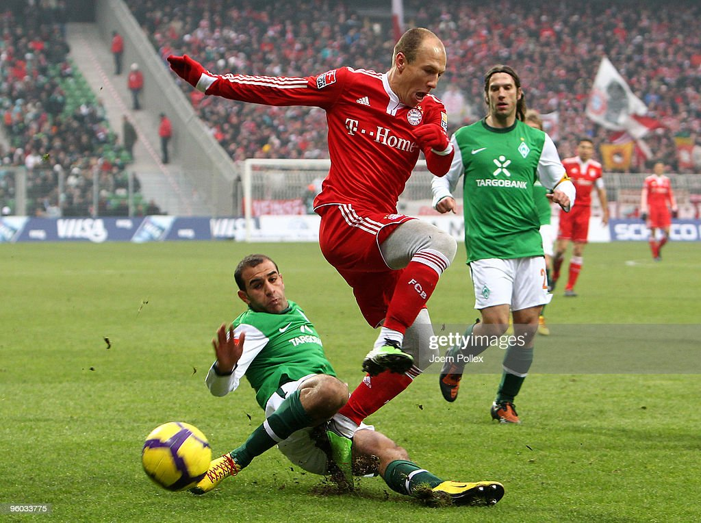 Aymen Abdennour of Bremen and Arjen Robben of Muenchen compete for the ball during the Bundesliga match between Werder Bremen and FC Bayern Muenchen at Weser Stadium on January 23, 2010 in Bremen, Germany.