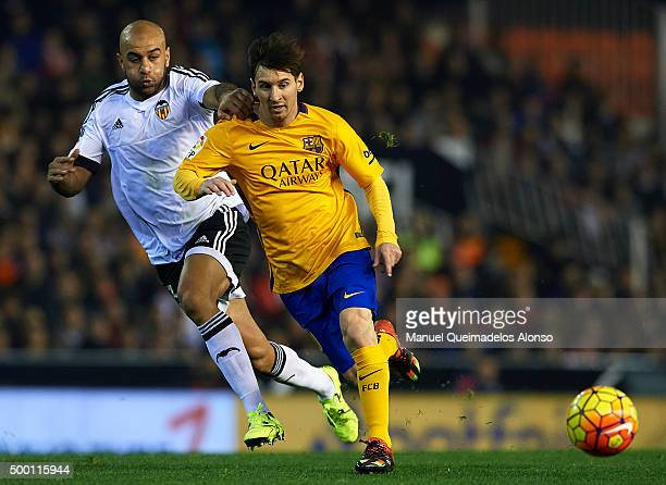 Aymen Abdennour of Valencia battle for the ball with Lionel Messi of Barcelona during the La Liga match between Valencia CF and FC Barcelona at...