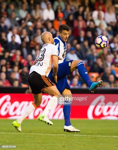 Aymen Abdennour of Valencia CF and Joselu Sanmartin Mato of Deportivo de la Corua during their La Liga match between Valencia CF and Deportivo de la...