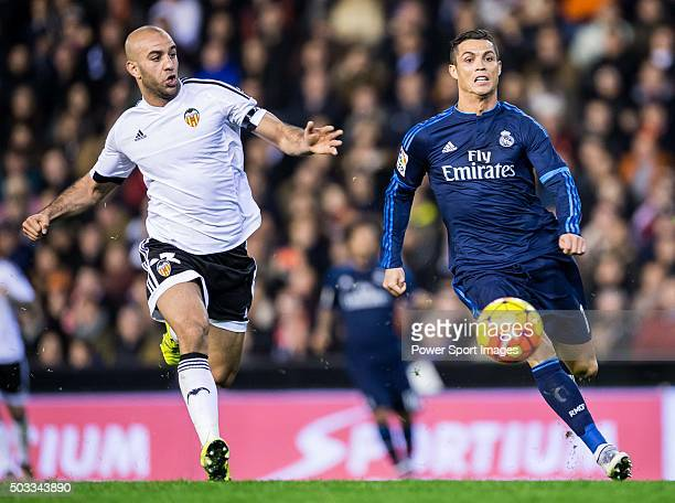 Aymen Abdennour of Valencia CF competes for the ball with Cristiano Ronaldo of Real Madrid CF during the Valencia CF vs Real Madrid CF as part of the...