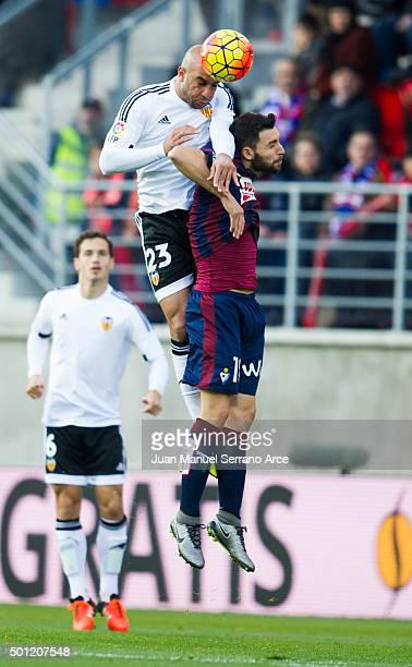 Aymen Abdennour of Valencia CF duels for the ball with Borja Gonzalez of SD Eibar during the La Liga match between SD Eibar and Valencia CF at Ipurua...