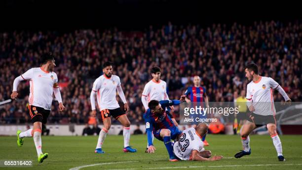 Aymen Abdennour of Valencia CF tackles Lionel Messi of FC Barcelona during the La Liga match between FC Barcelona and Valencia CF at Camp Nou stadium...