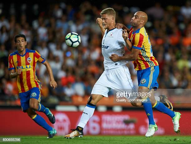 Aymen Abdennour of Valencia competes for the ball with Andreas Cornelius of Atalanta during the preseason friendly match between Valencia CF and...