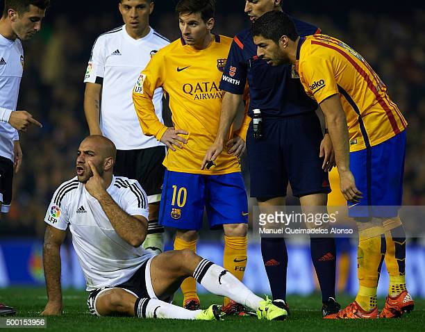 Aymen Abdennour of Valencia reacts next to Luis Suarez of Barcelona during the La Liga match between Valencia CF and FC Barcelona at Estadi de...