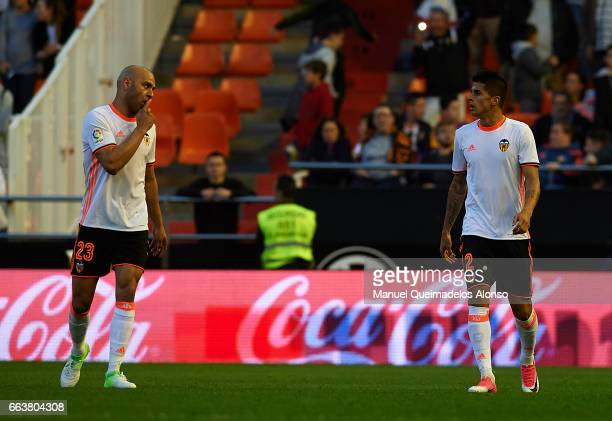 Aymen Abdennour of Valencia talks with his teammate Joao Cancelo during the La Liga match between Valencia CF and Deportivo de La Coruna at Mestalla...