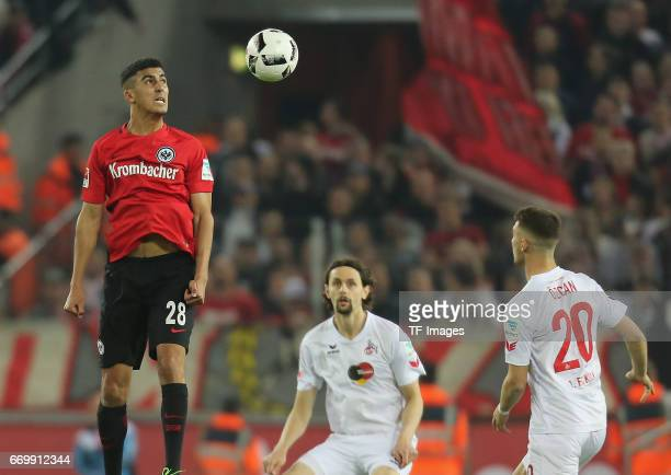 Aymen Barkok of Eintracht Frankfurt and Salih Oezcan of Cologne and Neven Subotic battle for the ball during the German Bundesliga soccer match...