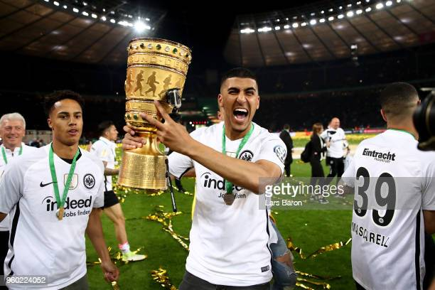 Aymen Barkok of Eintracht Frankfurt celebrate winning the Man of the match medal and the DFB Cup final against Bayern Muenchen at Olympiastadion on...