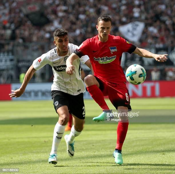 Aymen Barkok of Frankfurt and Vladimir Darida of Hertha battle for the ball during the Bundesliga match between Eintracht Frankfurt and Hertha BSC at...