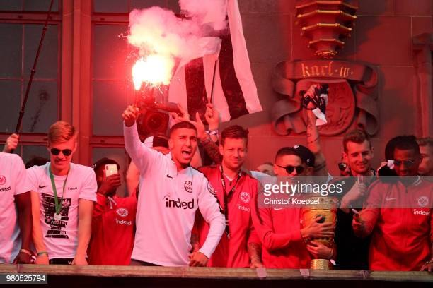 Aymen Barkok of Frankfurt fires a bengalo and celebrates with his team of Frankfurt the winning DFB Cup at the Roemer on May 20 2018 in Frankfurt am...