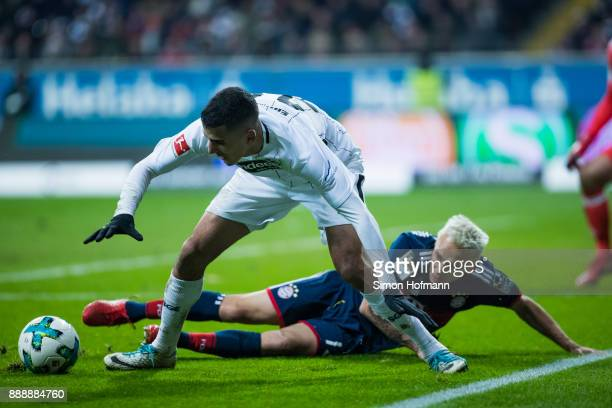Aymen Barkok of Frankfurt is challenged by Rafinha of Muenchen during the Bundesliga match between Eintracht Frankfurt and FC Bayern Muenchen at...