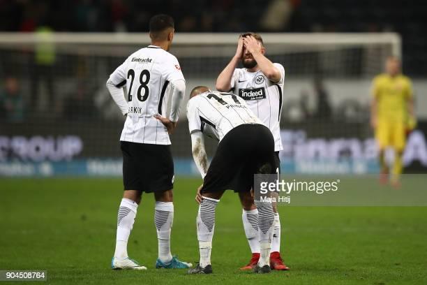 Aymen Barkok of Frankfurt Kevin PrinceBoateng of Frankfurt and Mijat Gacinovic of Frankfurt stand together after the Bundesliga match between...