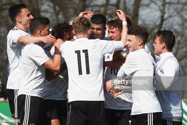 Aymen Barkok of Germany celebrates his team's first goal with team mates during the UEFA Elite Round match between U19 Germany and U19 Serbia at...