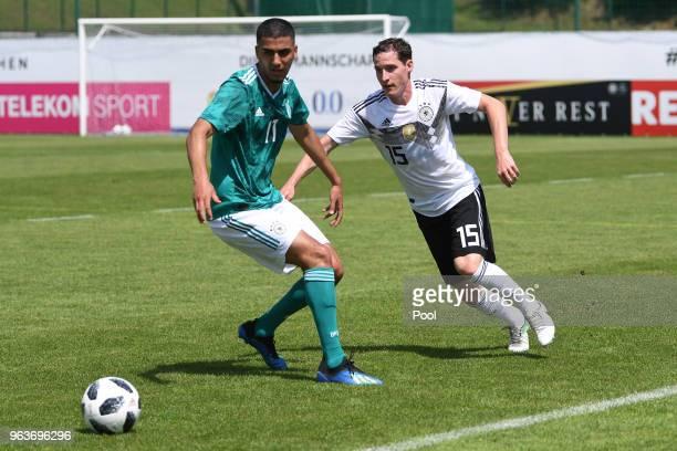 Aymen Barkok of Germany U20's and Sebastian Rudy of Germany during a Germany v Germany U20 test match at German national team training camp on May 30...