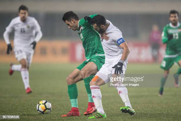 Aymen Hussein of Iraq fights for the ball with Yazan Al Arab of Jordan during the AFC U23 Championship China 2018 Group C match between Iraq and...