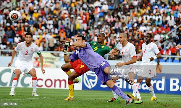 Aymen Mathlouthi of Tunisia attempts a save against Samuel Eto'o of Cameroon during the Africa Cup of Nations match between Cameroon and Tunisia from...