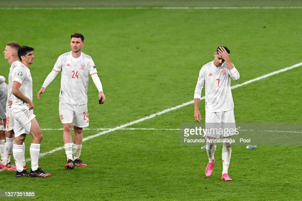 Aymeric Laporte and Alvaro Morata of Spain look dejected following defeat in the penalty shoot out after the UEFA Euro 2020 Championship Semi-final...