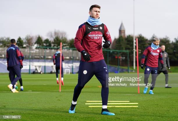 Aymeric Laporte and Cole Palmer of Manchester City in action during a training session at Manchester City Football Academy on December 11, 2020 in...