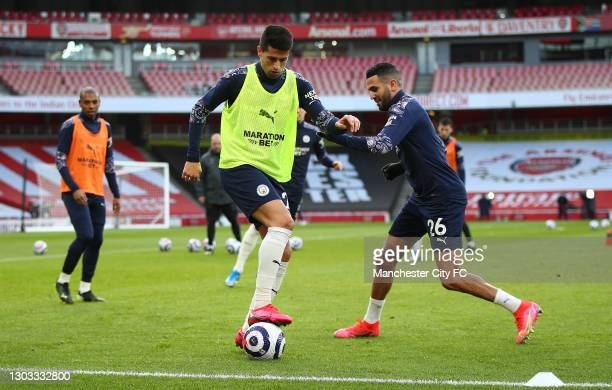 Aymeric Laporte and Riyad Mahrez of Manchester City warm up prior to the Premier League match between Arsenal and Manchester City at Emirates Stadium...