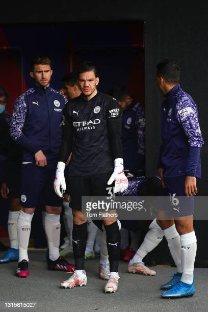 Aymeric Laporte, Ederson and Rodrigo of Manchester City look on from the tunnel prior to the Premier League match between Crystal Palace and...