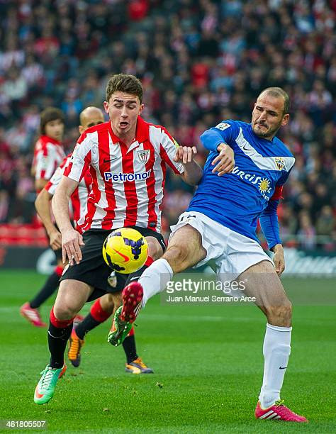 Aymeric Laporte of Athletic Club Bilbao competes for the ball with Fernando Soriano of UD Almeria during the La Liga match between Athletic Club...