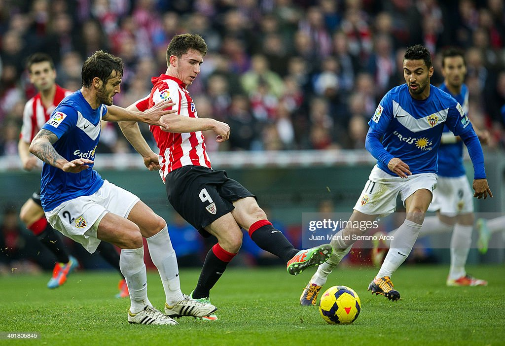 Aymeric Laporte (C) of Athletic Club Bilbao competes for the ball with Helder Barbosa (L) of UD Almeria during the La Liga match between Athletic Club Bilbao andÊUD AlmeriaÊat San Mames Stadium on January 11, 2014 in Bilbao, Spain.
