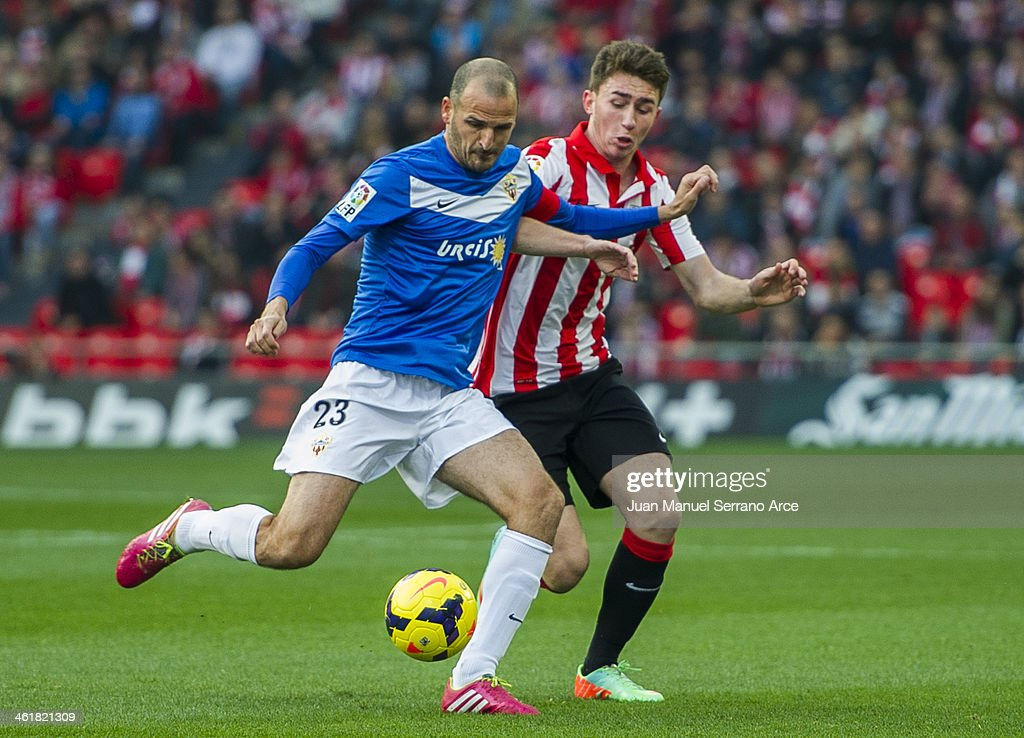 Aymeric Laporte of Athletic Club Bilbao competes for the ball with Fernando Soriano of UD Almeria during the La Liga match between Athletic Club Bilbao and UD Almeria at San Mames Stadium on January 11, 2014 in Bilbao, Spain.