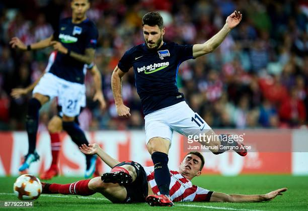 Aymeric Laporte of Athletic Club duels for the ball with Matthew Leckie of Hertha BSC during the UEFA Europa League group J match between Athletic...