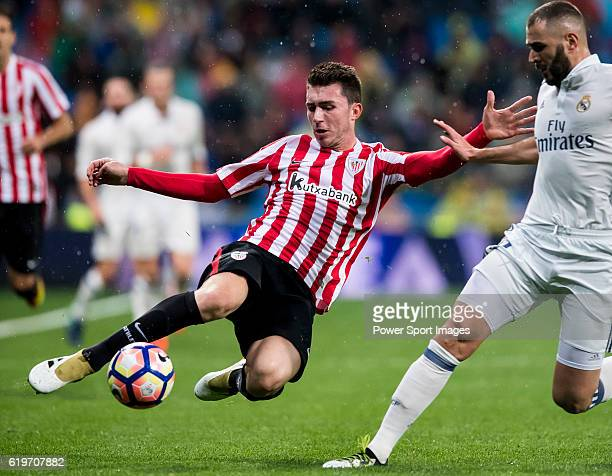 Aymeric Laporte of Athletic Club fights for the ball with Daniel Carvajal Ramos of Real Madrid during their La Liga match between Real Madrid and...